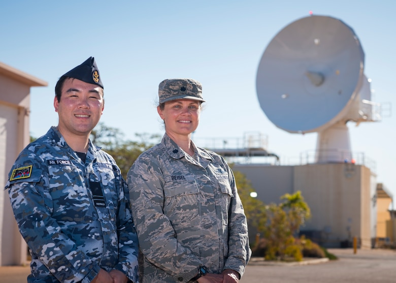Royal Australian Air Force Flight Lt. James Pak, RAAF No. 1 Remote Sensor Unit, and U.S. Air Force Lt. Col. Jennifer Beisel, space liaison officer , 21st Operations Group, 21st Space Wing, work together to monitor and operate a U.S.-owned C-Band space surveillance radar system at NCS Harold E. Holt, near Exmouth, Australia. Strategically located to cover both the southern and eastern hemisphere, the C-Band radar provides tracking and identification of space assets and debris for the U.S. space surveillance network.  (U.S. Navy photo by Mass Communication Specialist 2nd Class Jeanette Mullinax)