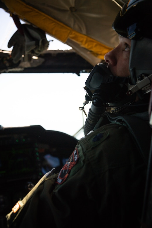Lt. Col. Ryan Decker, 343rd Bomb Squadron director of operations, scans the horizon from a B-52H Stratofortress flying out of Barksdale Air Force Base, La., May 1, 2020.