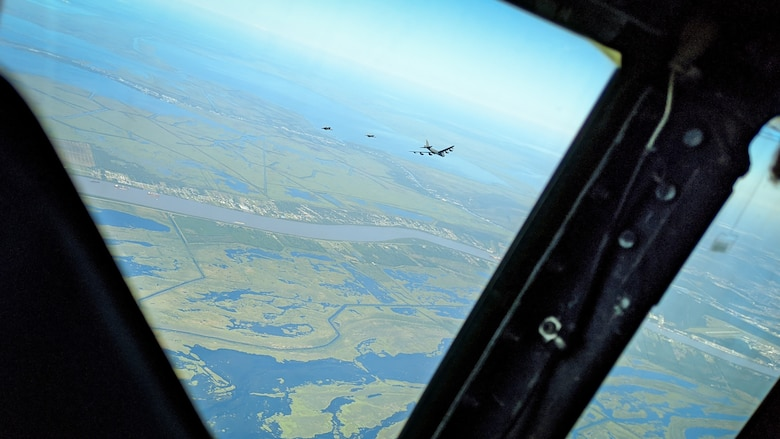 A B-52H Stratofortress and two F-15 Strike Eagles fly over South Louisiana, May 1, 2020.