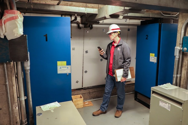 Brian Adkins, electrical engineer, U.S. Army Corps of Engineers – Omaha District, documents the elevator controls during a site assessment of a building in Omaha, Neb., the state is considering turning into an alternate care facility in the battle against the COVID-19 pandemic. When requested by states and/or territories and funded by FEMA, USACE is conducting site assessments for potential alternate care facilities. A site assessment does not guarantee construction at that site.
