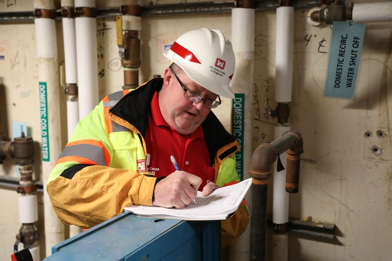 Brian Erbstosesser, fire protection engineer, U.S. Army Corps of Engineers – Omaha District, takes notes about a water supply system during a site assessment of a building in Omaha, Neb., the state is considering turning into an alternate care facility in the battle against the COVID-19 pandemic. When requested by states and/or territories and funded by FEMA, USACE is conducting site assessments for potential alternate care facilities. A site assessment does not guarantee construction at that site.