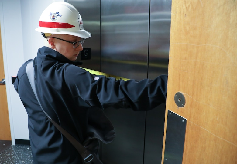 Andy Temeyer, architect, U.S. Army Corps of Engineers – Omaha District, measures the width of doors on an elevator April 6, during a site assessment of a building in Omaha, Neb., the state is considering turning into an alternate care facility in the battle against the COVID-19 pandemic. When requested by states and/or territories and funded by FEMA, USACE is conducting site assessments for potential alternate care facilities. A site assessment does not guarantee construction at that site.