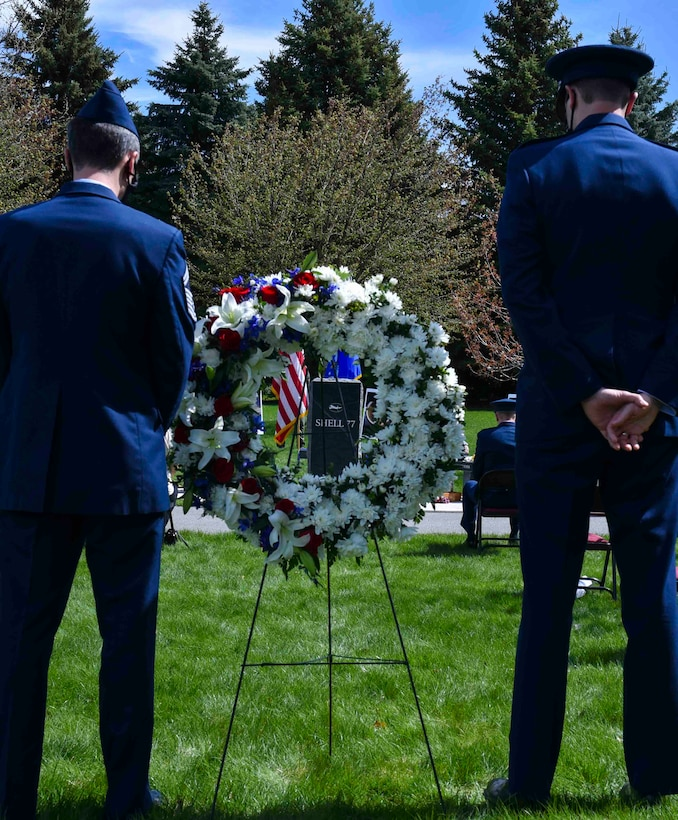 U.S. Air Force Lt. Col. Kevin Parsons, 93rd Air Refueling Squadron commander, and Senior Master Ryan Sgt. Clauss, 93rd Air Refueling Squadron superintendent, pause for a moment of silence during the Shell 77 Memorial, May 4, 2020, on Fairchild Air Force Base, Wash.