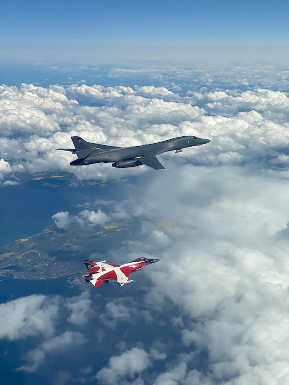 A B-1B Lancer flies with a Danish F-16 during a training mission for Bomber Task Force Europe, May 5, 2020. Aircrews from the 28th Bomb Wing at Ellsworth Air Force Base, South Dakota, took off on their long-range, long-duration Bomber Task Force mission to conduct interoperability training with Danish fighter aircraft and Estonian joint terminal attack controllers ground teams. Training with our NATO allies and theater partner nations contribute to enhanced resiliency and interoperability and enables us to build enduring relationships necessary to confront the broad range of global challenges. (Courtesy photo by Danish Air Force)
