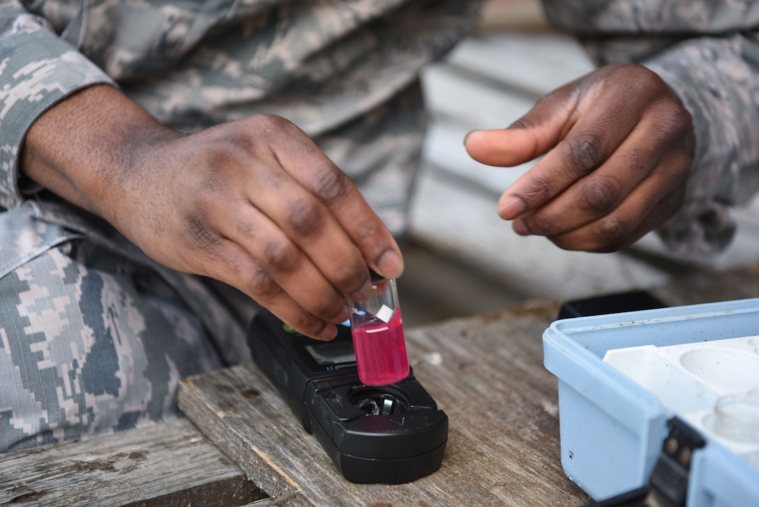 U.S. Air Force Senior Airman Brandon Williams, 786th Civil Engineer Squadron water and fuel systems maintenance journeyman, tests the chlorine level of a water vial.