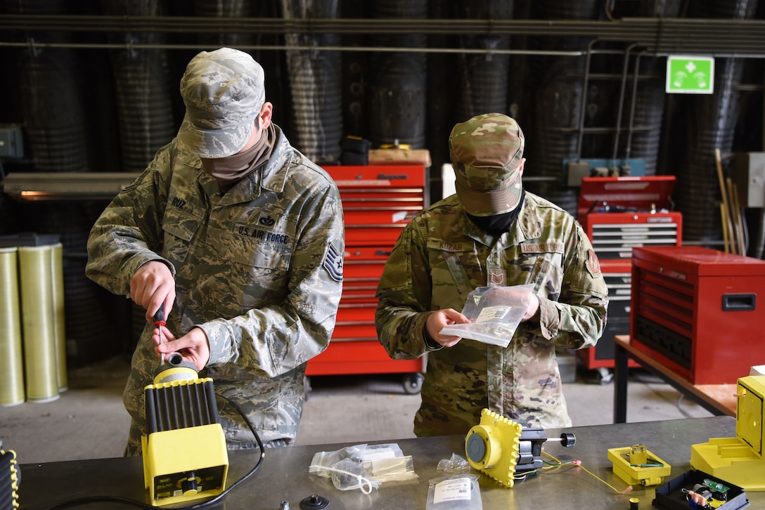 U.S. Air Force Tech Sgt. Isaac Ruz, 786th Civil Engineer Squadron water and fuel systems maintenance supervisor, left, and Tech Sgt. Nikki Kozar, 786th CES water plant noncommissioned officer in charge, conducts maintenance on water purification systems during proficiency training.