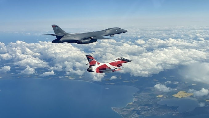 A B-1B Lancer flies with a Danish F-16 during a training mission for Bomber Task Force Europe, May 5, 2020. Aircrews from the 28th Bomb Wing at Ellsworth Air Force Base, South Dakota, took off on their long-range, long-duration Bomber Task Force mission to conduct interoperability training with Danish fighter aircraft and Estonian joint terminal attack controllers ground teams. Training with our NATO allies and theater partner nations contribute to enhanced resiliency and interoperability and enables us to build enduring relationships necessary to confront the broad range of global challenges.