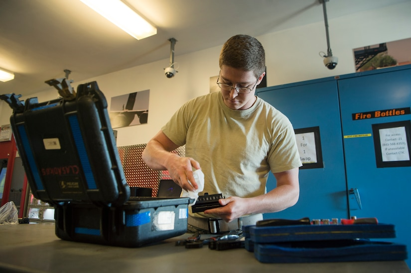 Senior Airman Sean Graves, 437th Aircraft Maintenance Squadron Viper Flight Composite Tool Kit Section custodian, sanitizes tools and equipment May 5, 2020, at Joint Base Charleston, S.C. The 437th AMXS CTK Section is responsible for the accountability of thousands of pieces of equipment including more than 2,000 tool kits. The CTK team implemented a process where maintainers disinfect their tools prior to turn in. After communicating over radio, tools are sanitized in a designated room used for tool transfer with personnel keeping a six foot distance to help prevent health risks associated with COVID-19.
