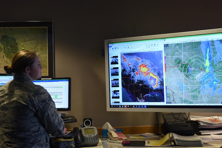 Airman 1st Class Wendi Mueller, a 28th Operations Support Squadron weather apprentice, reviews radar imagery for a weather report at Ellsworth Air Force Base, S.D., May 4, 2020. This weather report was used to inform aviators in preparation for a non-stop deployment to the U.S. European Command area of responsibility. (U.S. Air Force photo by Staff Sgt. Hailey Staker)