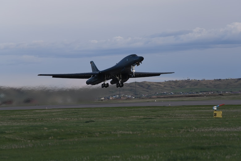 A B-1B Lancer launches for a non-stop deployment from Ellsworth Air Force Base, S.D., May 4, 2020. U.S. Strategic Command routinely conducts Bomber Task Force operations across the globe as a demonstration of U.S. commitment to collective defense and to integrate with Geographic Combatant Command operations and activities. (U.S. Air Force photo by Senior Airman Nicolas Z. Erwin)