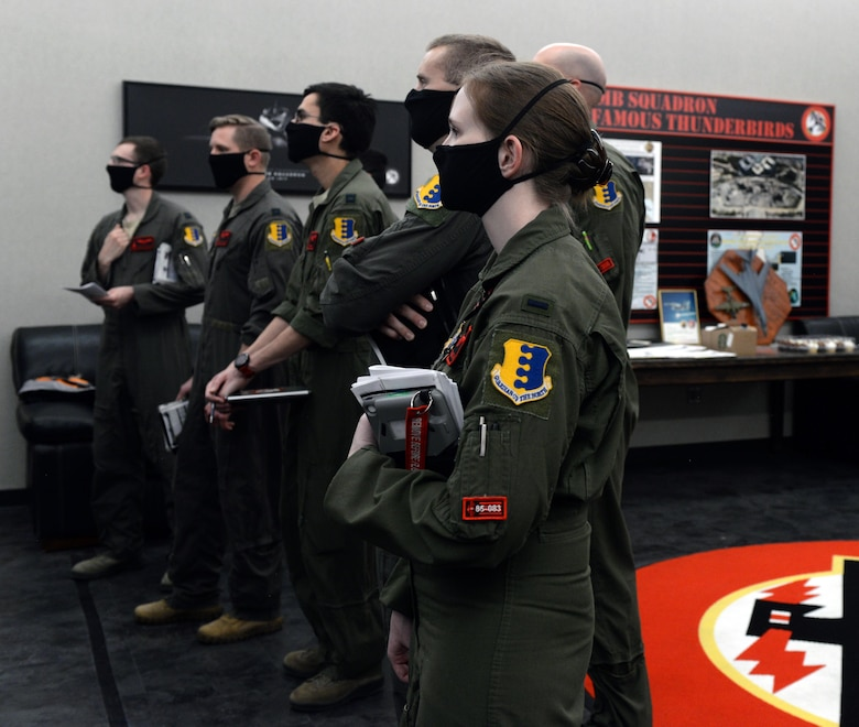 Aircrew from the 34th Bomb Squadron attend a step brief for a non-stop deployment from Ellsworth Air Force Base, S.D., May 4, 2020.  U.S. Strategic Command Bomber Task Force operations provide opportunities to work and train with U.S. allies and partners, and strengthen capabilities by familiarizing aircrew with airbases and operations in different parts of the globe. (U.S. Air Force photo by Airman Quentin Marx)