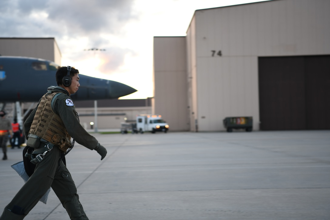 An aviator assigned to the 34th Bomb Squadron, Ellsworth Air Force Base, S.D., heads to the squadron following a more than 25-hour non-stop mission May 5, 2020. Bomber deployments and operations enhance the readiness and training necessary to respond to any contingency or challenge across the globe. (U.S. Air Force photo by Senior Airman Nicolas Z. Erwin)