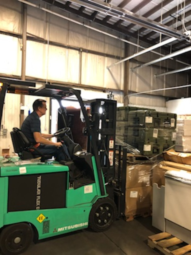 Property Disposal Specialist Eddie Sanders moves some of the $330,000 worth of medical equipment and supplies intended for first responders fighting COVID-19 throughout Florida. The material is from DLA Disposition Services' site at Fort Bragg, North Carolina.