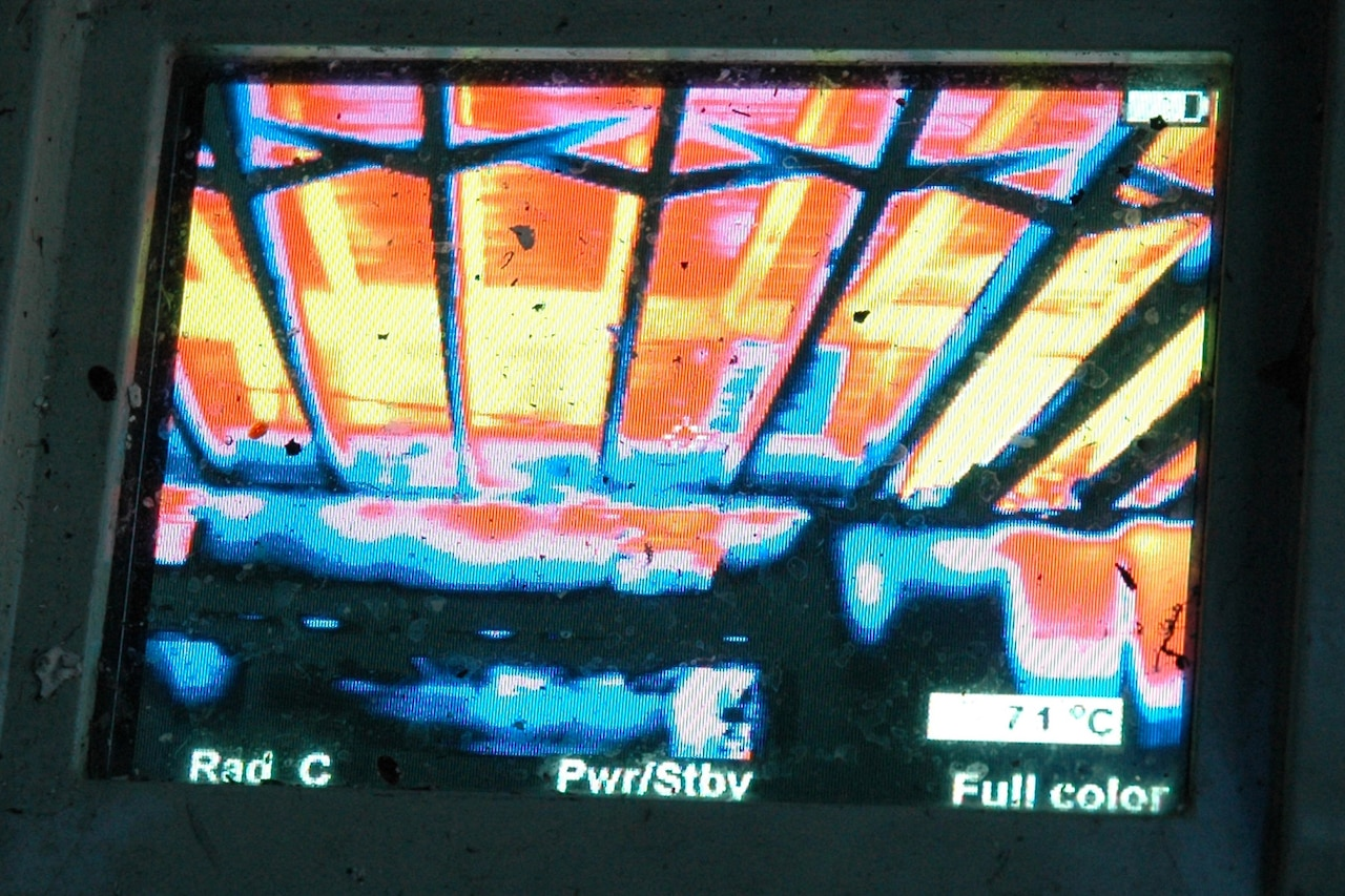 A thermal image shows a house fire.