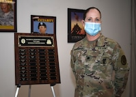 Lt. Col. Kristine Broger, the deputy commander for nursing, U.S. Army Medical Department Activity (MEDDAC), Fort Drum, N.Y., stands next to a plaque commemorating the MEDDAC's nationally board-certified nurses during the National Nurses Week kick-off celebration at the Guthrie Ambulatory Healthcare Clinic on Fort Drum, May 6.