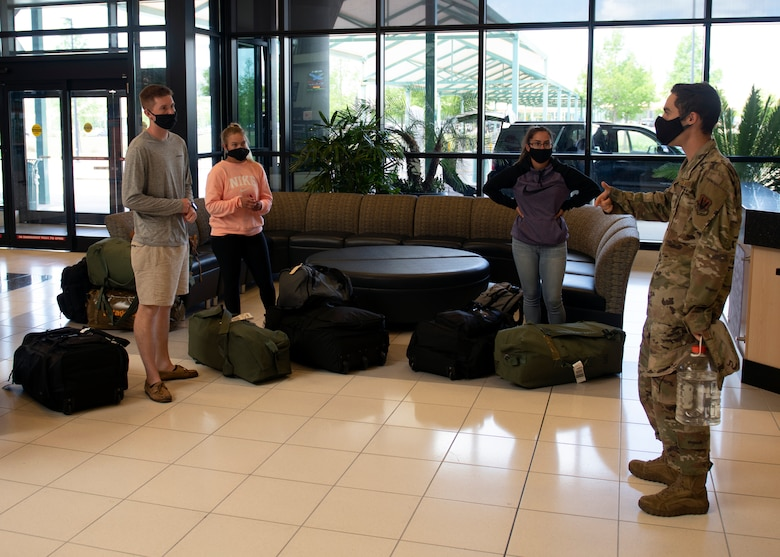 A member of Task Force Roadrunner briefs Airmen on new inprocessing procedures at the Northwest Florida Beaches International Airport in Panama City, Florida, May 5, 2020. Task Force Roadrunner was established at Tyndall Air Force Base to allow technical training graduates to safely inprocess during the COVID-19 Pandemic. (U.S. Air Force photo by Brad Sturk)