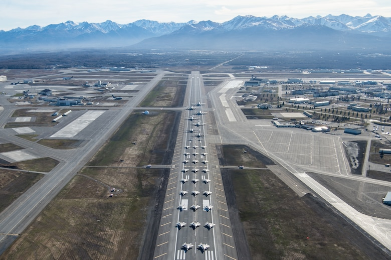 U.S. Air Force aircraft assigned to the 3rd Wing, 176th Wing and 477th Fighter Group participate in a close formation taxi, known as an Elephant Walk, at Joint Base Elmendorf-Richardson, Alaska, May 5, 2020. The large show-of-force demonstrated the wings' rapid mobility capabilities and response readiness during COVID-19 and also highlighted the ability to generate combat airpower at a moment's notice to ensure regional stability throughout the North American Aerospace Defense Command Region and Indo-Pacific. Aircraft included F-22 Raptors, C-17 Globemaster IIIs, E-3 Sentrys, C-12F Hurons, C-130J Super Herculeses and HH-60G Pave Hawks.