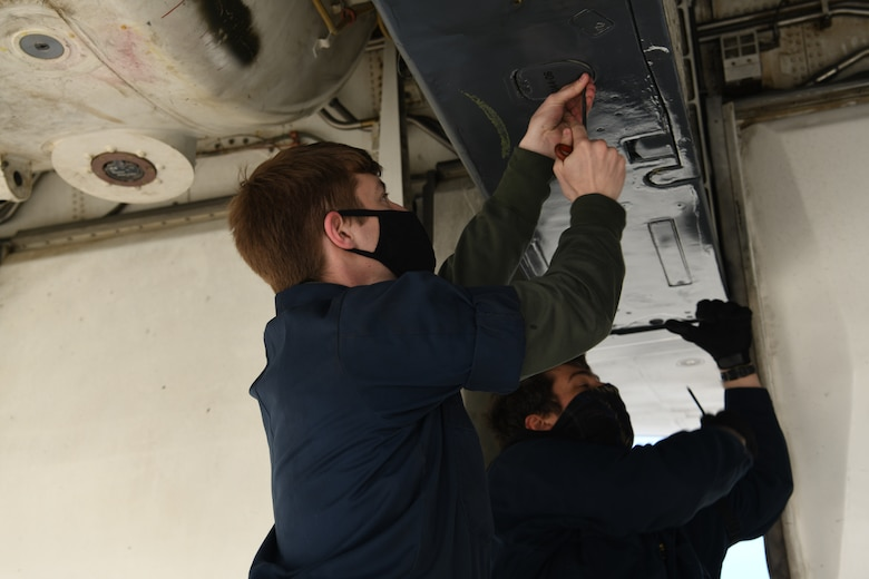 Airmen assigned to the 28th Aircraft Maintenance Unit inspect a B-1B Lancer prior to a non-stop deployment from Ellsworth Air Force Base, S.D., May 4, 2020. The Department of Defense maintains command and control of its bomber forces for any mission, anywhere in the world, at any time. (U.S. Air Force photo by Senior Airman Nicolas Z. Erwin)