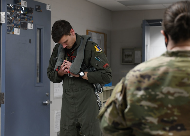 An aviator from the 34th Bomb Squadron prepares his flight equipment prior to a more than 25-hour non-stop mission from Ellsworth Air Force Base, S.D., May 4, 2020. Bomber Task Force deployments enhance the readiness and training necessary to respond to any contingency or challenge across the globe.  (U.S. Air Force photo by Airman 1st Class Christina Bennett)
