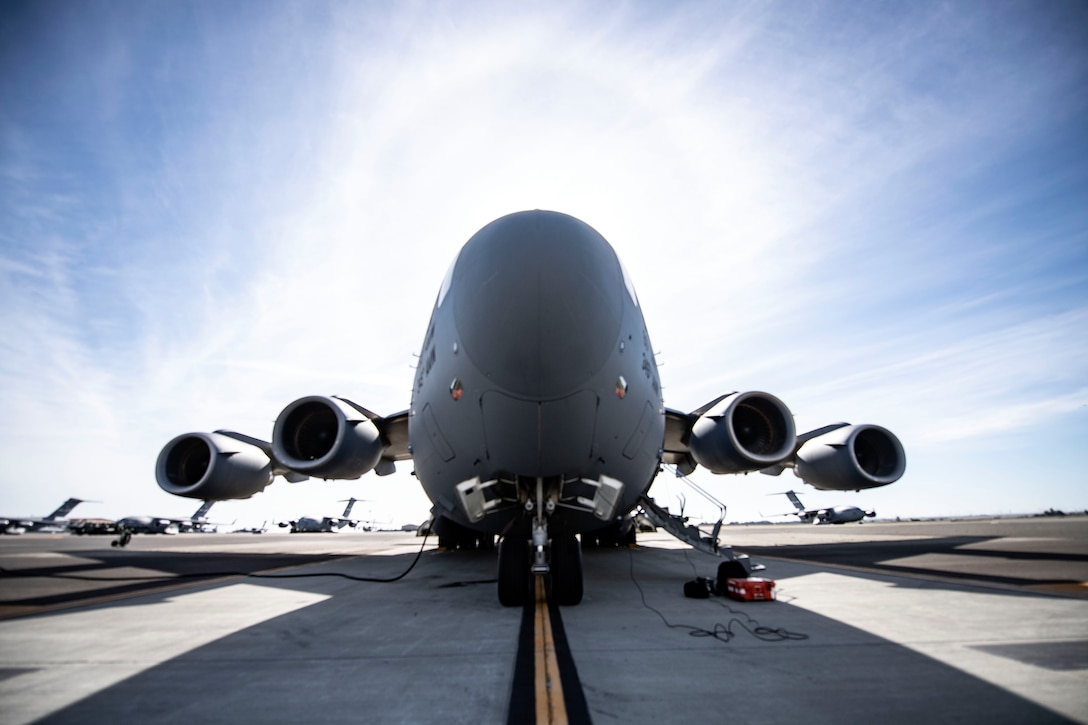 A C-17 Globemaster III is parked on the Travis flight line April 27, 2020, at Travis Air Force Base, California. As of now, only the C-17, C-130H Hercules and C-130J Super Hercules are capable of carrying Transport Isolation System capsules. TIS capsules, which were initially engineered in response to the Ebola virus in 2014, allow the transport of individuals with highly contagious diseases without infecting any other passengers or aircrew on the aircraft. (U.S. Air Force photo by Senior Airman Christian Conrad)
