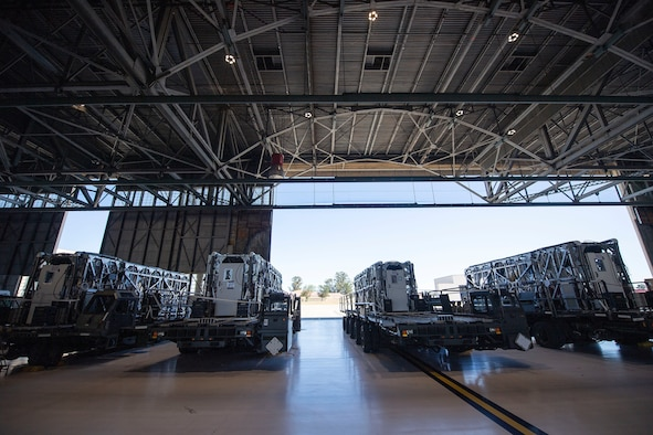 Transport Isolation System capsules are positioned on respective cargo K loaders in a hangar April 28, 2020, at Travis Air Force Base, California. TIS capsules, which were initially engineered in response to the Ebola virus in 2014, allow the transport of individuals with highly contagious diseases without infecting any other passengers or aircrew on the aircraft. (U.S. Air Force photo by Senior Airman Christian Conrad)
