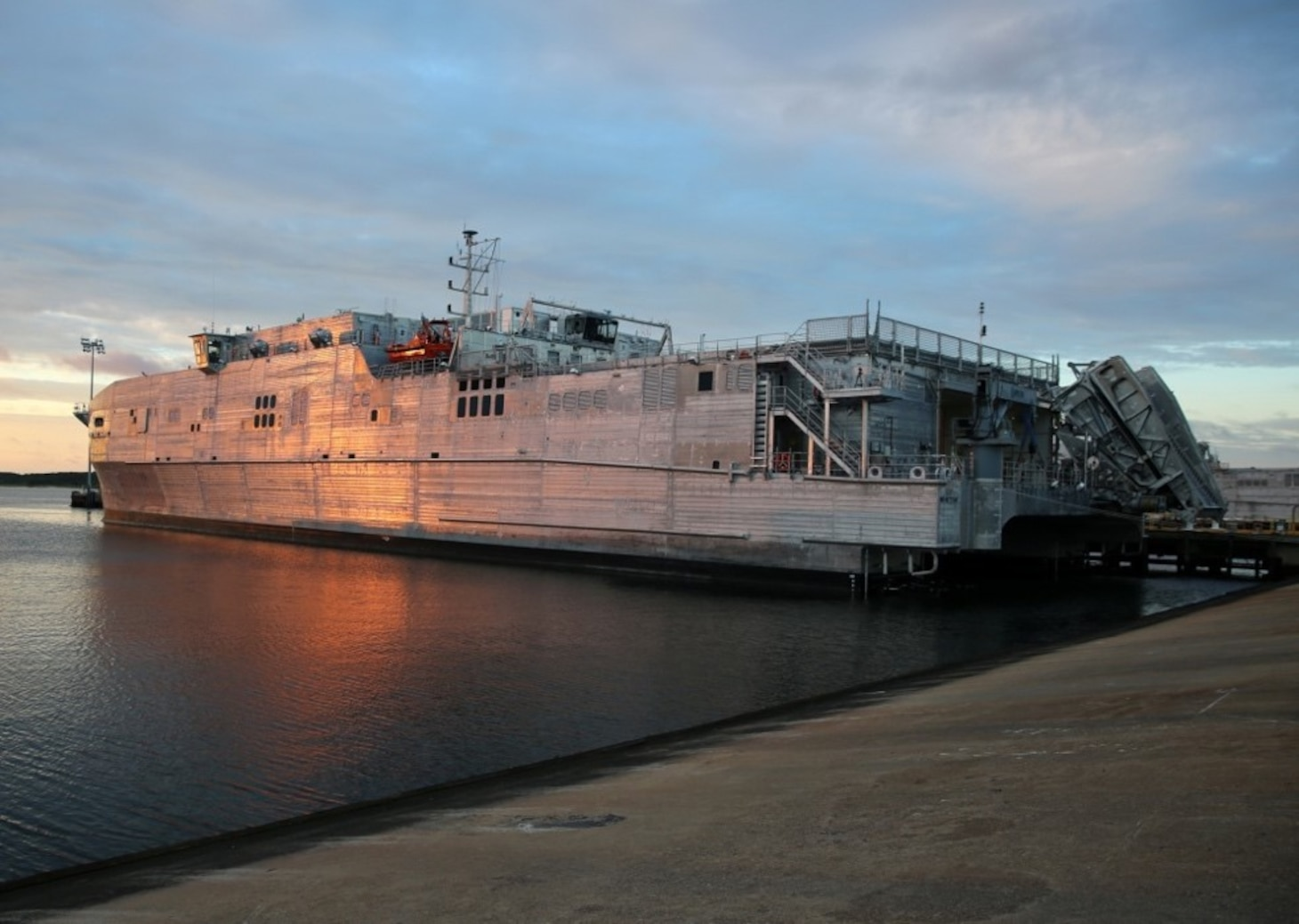 170701-N-OH262-002 VIRGINIA BEACH, Va. (July 1, 2017) -- A view of Military Sealift Command's expeditionary fast transport ship USNS Yuma (T-EPF 8) pier-side onboard Joint Expeditionary Base Little Creek-Fort Story, July 1. EPF class ships are designed to transport 600 short tons of military cargo 1,200 nautical miles at an average speed of 35 knots. The ship is capable of operating in austere ports and waterways, interfacing with roll-on/roll-off discharge facilities, and on/off-loading a combat-loaded Abrams main battle tank. (U.S. Navy photograph by Bill Mesta/released)