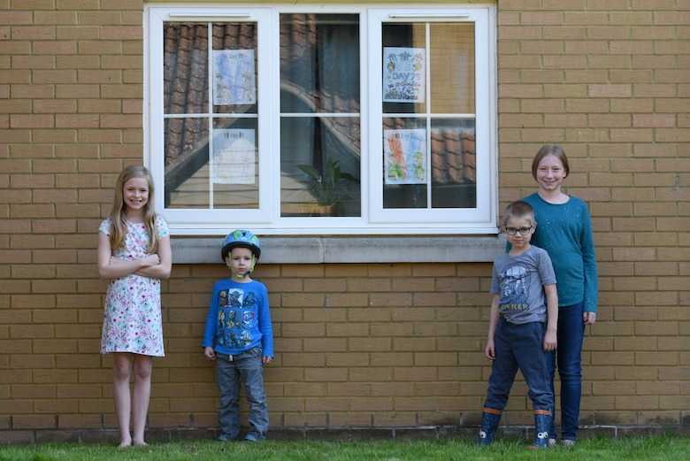 Children of a U.S. Air Force Airman display Victory in Europe Day artwork in their windows in Liberty Village at Royal Air Force Lakenheath, England, May 6, 2020. On May 8, the U.K. will join the U.S. and allies around the world to mark the 75th anniversary of VE Day, with virtual programs to avoid the spread of COVID-19. (U.S. Air Force photo by Airman 1st Smith Rhonda Smith)