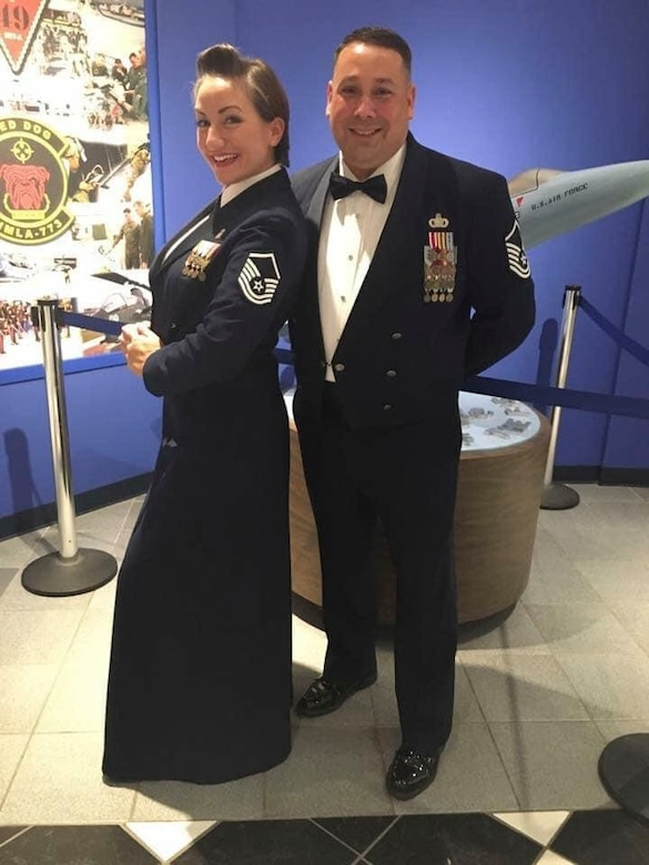 """U.S. Air Force Master Sgt. Amanda """"Mae"""" Arguello, 52nd Fighter Wing deputy chief, wing protocol, and Senior Master Sgt. Alvin """"Al"""" F. Arguello II, Air Force Security Forces Center superintendent of strategic plans and programs, pose for a photo at a ceremony in 2017 at Robins Air Force Base, Georgia. Al and Mae have been coping with the COVID-19 pandemic by continuing to grow in their marriage despite the temporary distance the virus caused. (Photo courtesy of Master Sgt. Amanda """"Mae"""" Arguello)"""