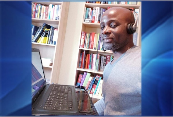 Sammy Sobah II sits in his home office
