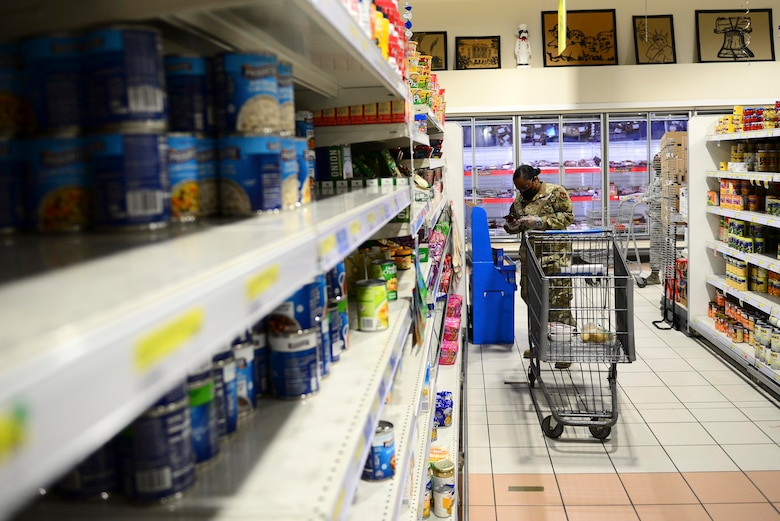 U.S. Air Force Tech. Sgt. Kahlia Rainer, volunteer, checks a grocery list at the commissary on Aviano Air Base, Italy, April 18, 2020. Spouses and dependents of active duty members unable to shop for themselves due to restrictions in place during the ongoing battle against COVID-19 were able to sign up for the grocery delivery service and send a shopping list to their volunteer. (U.S. Air Force photo by Tech. Sgt. Tory Cusimano)