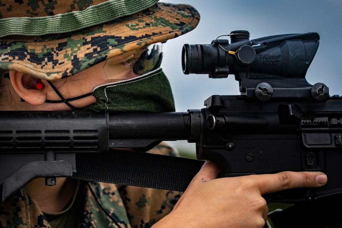 A U.S. Marine sights in on her target on Camp Hansen, Okinawa, Japan, May 6.