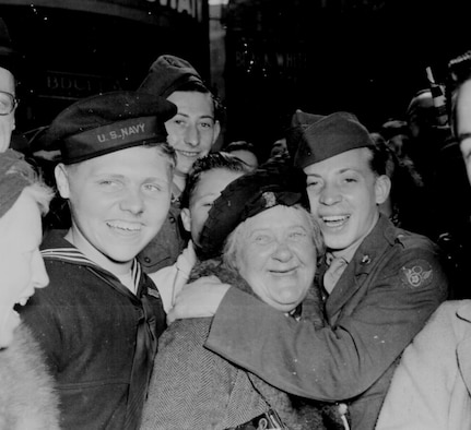American service members and British citizens celebrate Germany's unconditional surrender, May 7, 1945 at Piccadilly Circus, London.