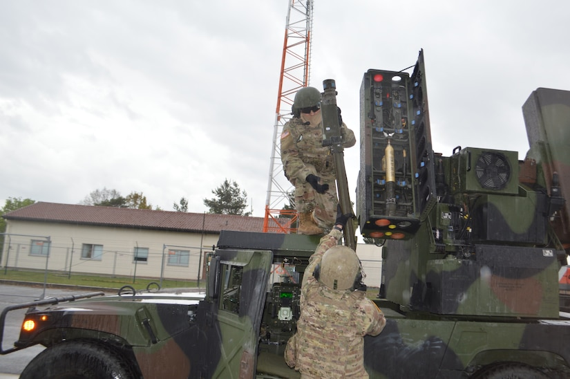 Soldiers load a missile into a short-range air defense missile system.