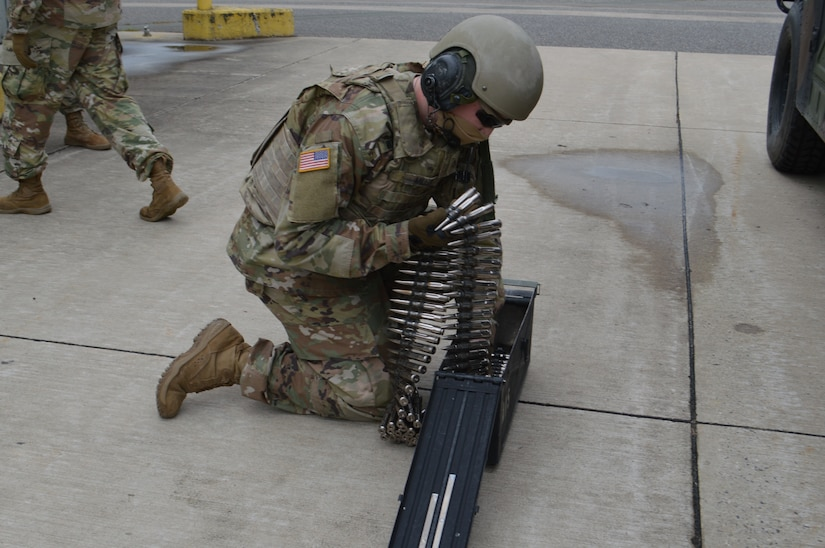 A soldier loads ammo into a magazine.