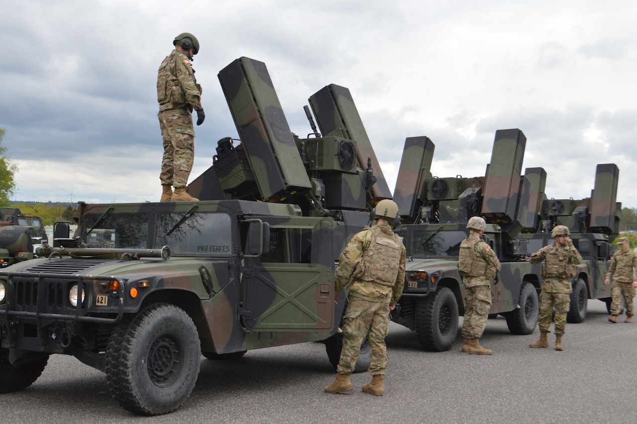 Soldiers ready a short-range air defense missile system.