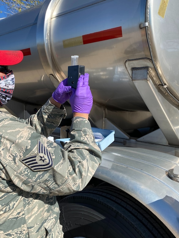 A member of the New Mexico National Guard checks the purity of a truckload of water. Airmen and Soldiers of the New Mexico National Guard Joint Task Force are supplying food and water to New Mexico communities during the COVID-19 response mission.