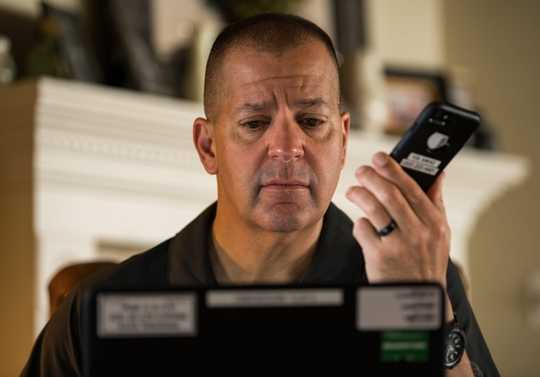Lt. Col. James Wall, 436th Airlift Wing inspector general and current battle staff director, teleworks from his house using government equipment April 28, 2020, on Dover Air Force Base, Delaware. Wall, the battle staff and Team Dover members resorted to teleworking, if possible, after shelter-in-place orders were put into place in mid-March to help mitigate the spread of COVID-19. (U.S. Air Force photo by Roland Balik)