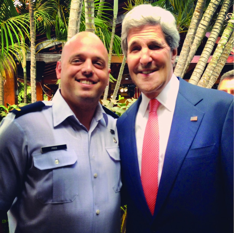 Capt Christopher Price with Former Secretary of State John Kerry at the U.S. Embassy in Brasilia, Brasil. Photo compliments of Capt Christopher Price.