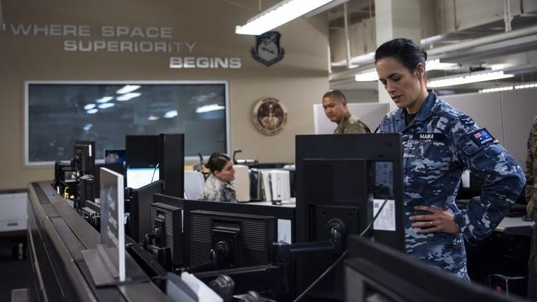 Royal Australian Air Force Squadron Leader Jamiee Maika is seen in the Combined Space Operations Center (CSpOC) at Vandenberg Air Force Base, California. Additional nations collaborating on space operations with the CSpOC include Germany, France and New Zealand.