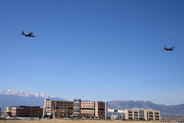 Image shows two large aircraft flying over Colorado Springs hospital