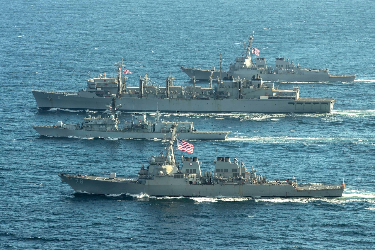 U.S. and British naval ships transit the ocean.