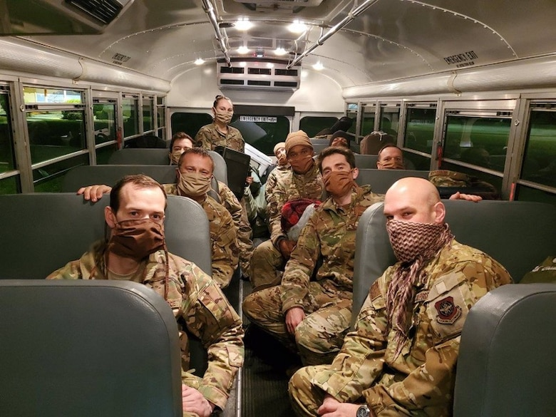 Members of the 22nd Airlift Squadron wear face masks April 11, 2020, during a deployment to Germany. The masks were made by Jenn Taylor, a military spouse who sewed more than 325 masks in April for the Travis Air Force Base, California, community. Taylor's husband, Tech. Sgt. Adam Taylor, a Travis AFB Airman, is on a yearlong deployment to Incirlik Air Base, Turkey. (Courtesy photo)
