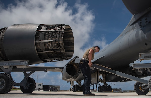 Senior Airman Shelby Ries, 7th Aircraft Maintenance Squadron aerospace propulsion mechanic, loads an engine onto a trailer at Andersen Air Force Base, Guam, May 3, 2020. The B-1 has four engines that can produce 30,000 lbs. of thrust each. Four B-1Bs deployed to Andersen as part of U.S. Strategic Command's support to the National Defense Strategy objectives of strategic predictability and operational unpredictability by using a mix of different aircraft to and from various dispersed U.S. bases and other departure and arrival points, to include Guam. (U.S. Air Force photo by Senior Airman River Bruce)