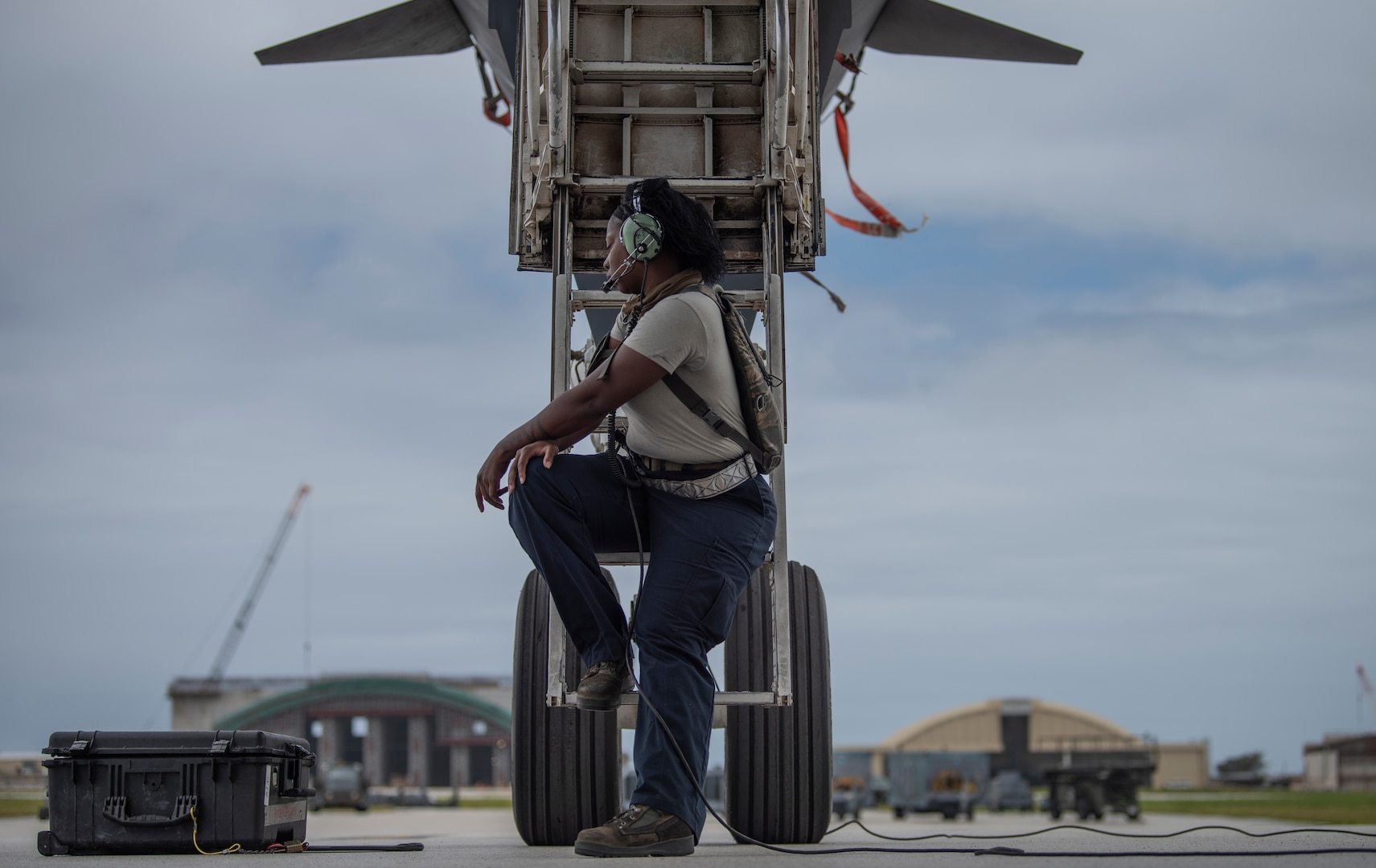Senior Airman Raisa Ward, 9th Expeditionary Bomb Squadron Aircraft Maintenance Unit avionics technician, sits under a 9th EBS B-1B Lancer at Andersen Air Force Base, Guam, May 5, 2020, after completing maintenance on the aircraft. The 9th EBS, and other units assigned to the 7th Bomb Wing of Dyess Air Force Base, Texas, are deployed to Guam as part of a Bomber Task Force. BTFs contribute to joint force lethality, assure allies and partners, and deter aggression in the Indo-Pacific. (U.S. Air Force photo by Senior Airman River Bruce)