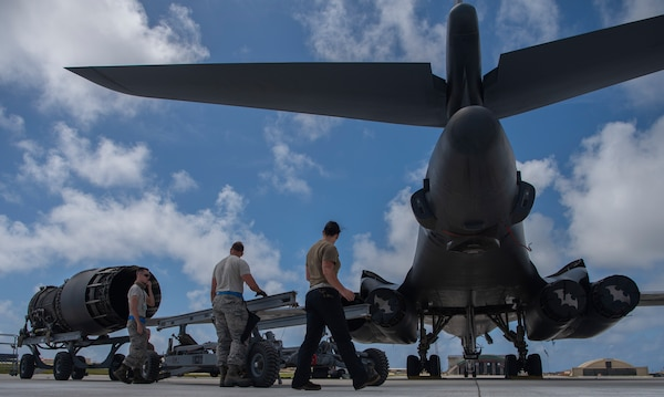 7th Aircraft Maintenance Squadron B-1B Lancer aircraft mechanics prepare to load an engine at Andersen Air Force Base, Guam, May 3, 2020. The B-1 carries four engines that help it reach speeds of more than 900 mph. A Bomber Task Force of four B-1s and approximately 200 Airmen deployed to Andersen as part of the Air Force's dynamic force employment initiative. (U.S. Air Force photo by Senior Airman River Bruce)