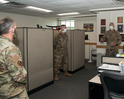 While performing the duties of Under Secretary of the Air Force Shon Manasco and Chief Master Sgt. of the Air Force Kaleth O. Wright listen to Master Sgt. Brandon Long, 37th Training Wing Detachment 5 military training instructor, as he briefs on the physical-training procedures used by basic military trainees at Keesler Air Force Base, M