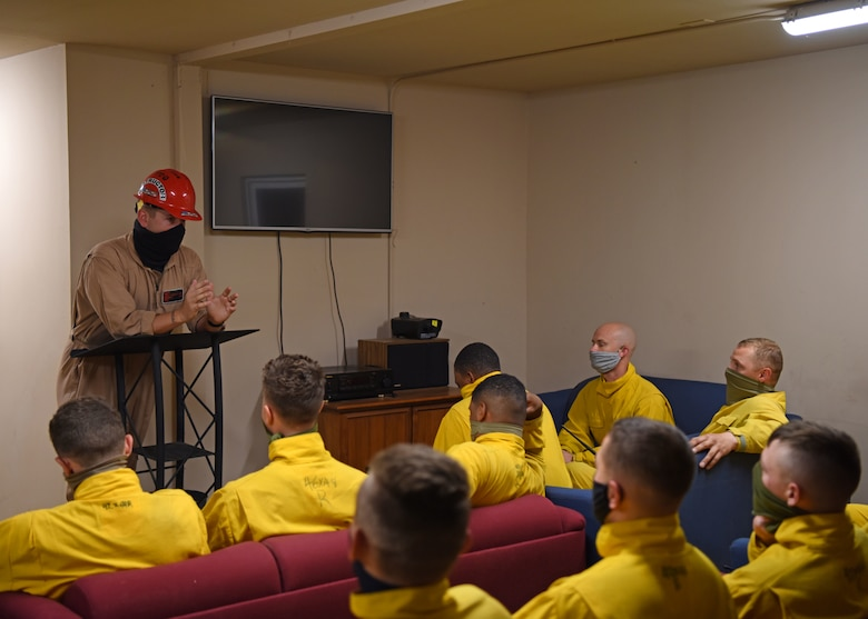 U.S. Air Force Staff Sgt. Jonathan Kidd, 312th Training Squadron Block III instructor, briefs his class on their upcoming exercise at the Louis F. Garland Department of Defense Fire Academy on Goodfellow Air Force Base, Texas, May 6, 2020. The class was required to use face masks at all times to protect themselves and others from COVID-19. (U.S. Air Force photo by Airman 1st Class Ethan Sherwood)