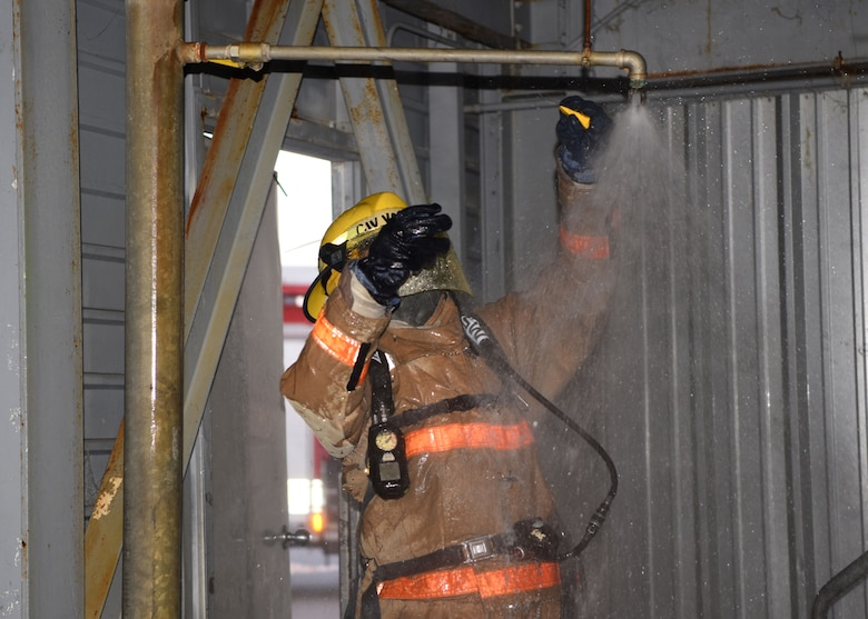 A 312th Training Squadron student responds to a call about a leak during the final exercise of Block III at the Louis F. Garland Department of Defense Fire Academy on Goodfellow Air Force Base, Texas, May 6, 2020. Firefighters were trained for much more than just responding to fires, they also handle leaks, structural damage, rescue, and other crises. (U.S. Air Force photo by Airman 1st Class Ethan Sherwood)