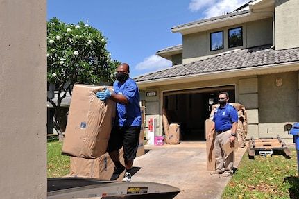Household goods inspector Faata Leafa performs an inspection of a household goods packout performed by Aloha International. They all are practicing social distancing and wearing facemasks.
