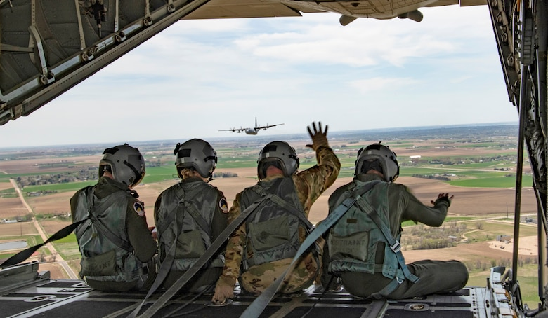 Members of the 302nd Airlift Wing wave to Colorado healthcare workers, first responders and essential employees battling COVID-19 during a flyover in May. The 302nd AW was one of numerous Reserve wings that utilized normal training flights to salute Americans on the front line against the COVID-19 virus. (Staff Sgt. Laura Turner)